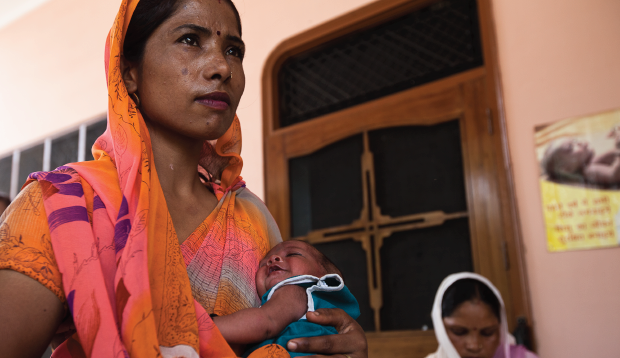 Mom and baby seeking care in rural India