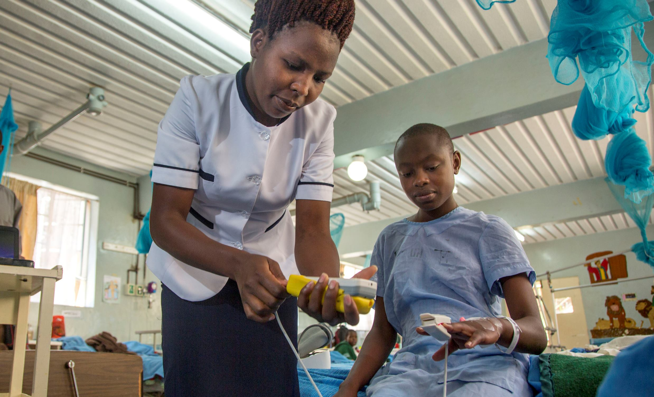 Nurse and patient in Kenya