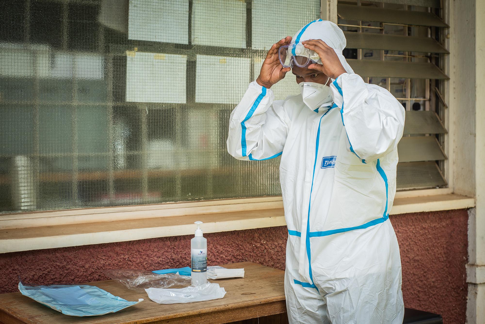 Health worker dons PPE in Kenya.