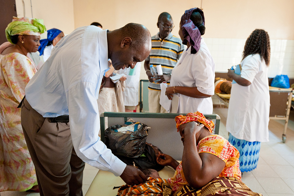Pape Gaye visits a health facility in Senegal. Photo by Clément Tardif for IntraHealth International.