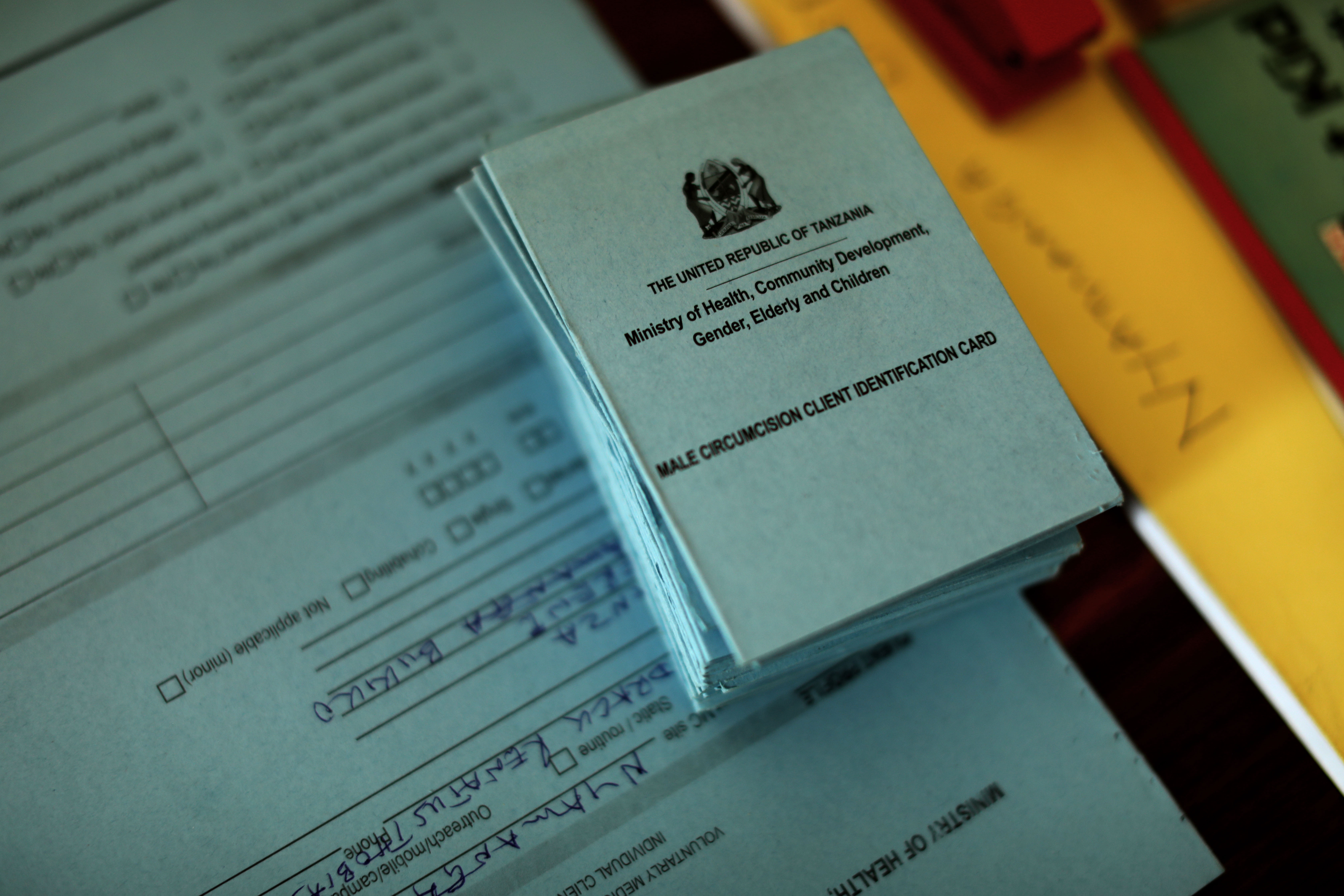 A male circumcision client identification card in Tanzania. Photo by Josh Estey for IntraHealth International.