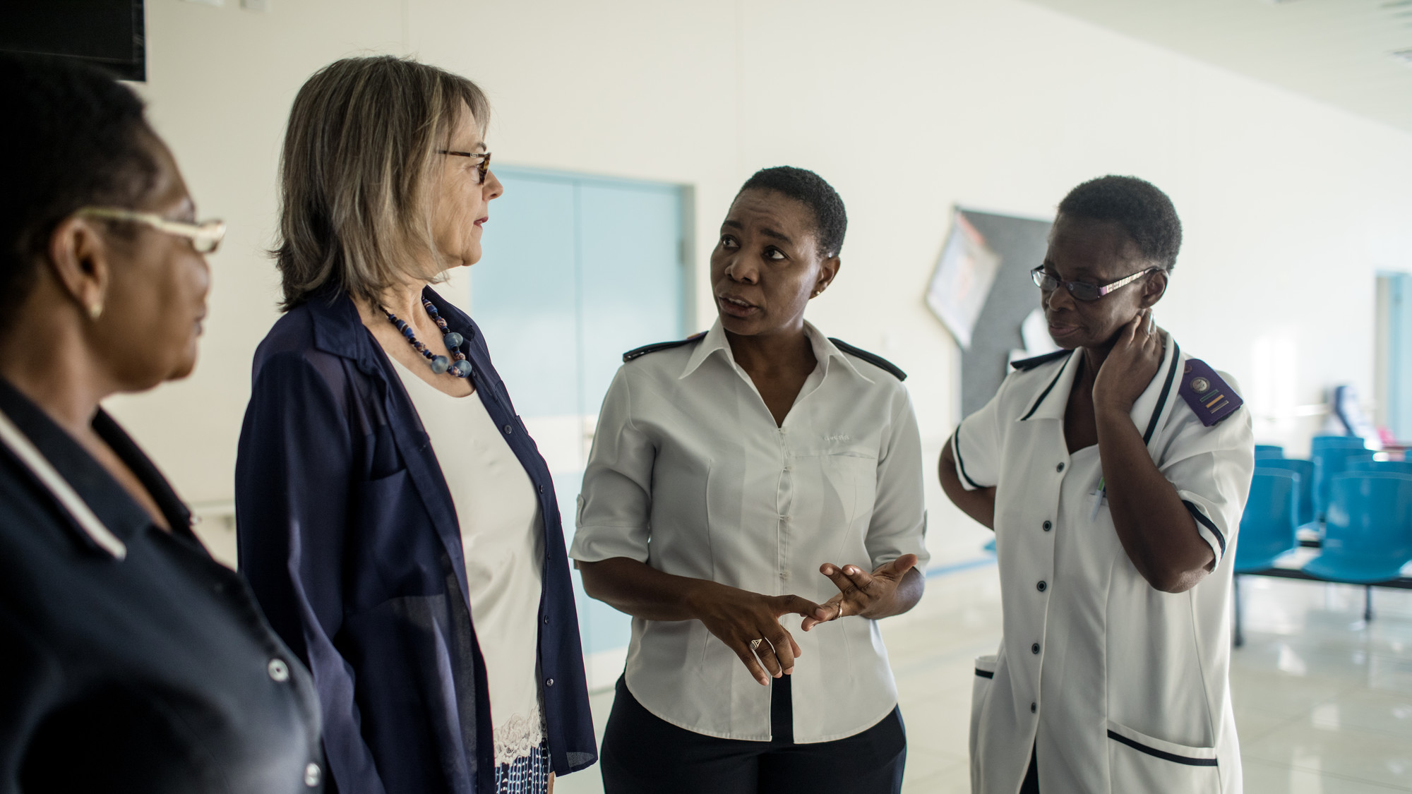 Pamela McQuide (second from left) talks with HIV nurses in a hospital in Namibia.