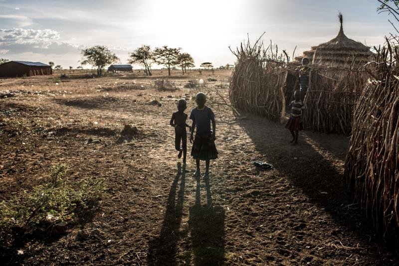 Family members stand outside their home a few minutes' walk from the Nadunget Health Center in Karamoja.
