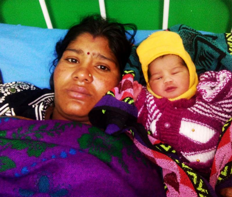 Preeti safely delivered a healthy baby girl with the help of Rakhi, a frontline health worker. Preeti and her husband now have four daughters and feel their family is complete. Photo courtesy of Gauri Bisht.
