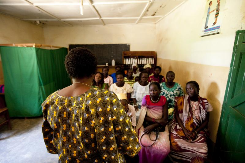 A nurse at the Saint Bakhita Health Centre in Yei discusses family planning and HIV counseling and testing with clients before their routine antenatal visits. IntraHealth has worked with the health center since 2007 to train and support Sister Veronika's staff of health workers. Photo by Trevor Snapp for IntraHealth International.