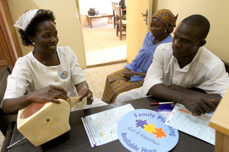A couple, Mr. Olatunji Yusuf and Mrs. Nimota Yusuf, attend a family planning counseling session with a service provider at a Centre-Igboro health facility in Ilorin, Kwara state, Nigeria. © 2012 Akintunde Akinleye/NURHI, Courtesy of Photoshare.
