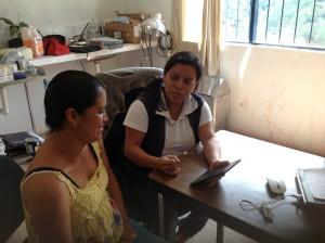 A CES health worker field tests the app with a patient. Photo courtesy of Hesperian Health Guides.