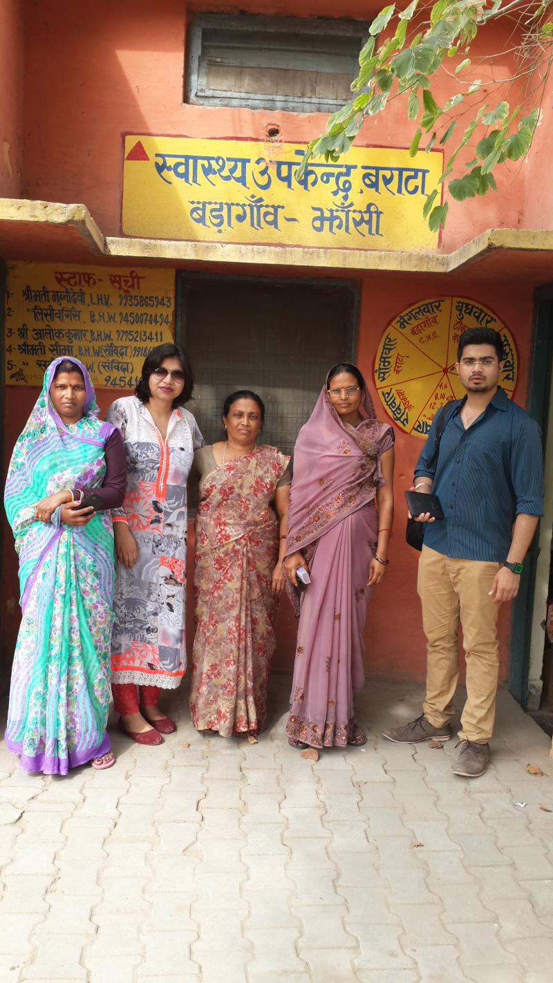 Reema Sharma (second from left) poses with accredited social health activists, or ASHAs, outside of a health center in Jhansi District, Uttar Pradesh, India. Photo courtesy of Reema Sharma.