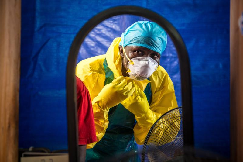 A health worker dons protective gear before entering an Ebola treatment center in the west of Freetown, Sierra Leone. (AP Photo/Michael Duff)