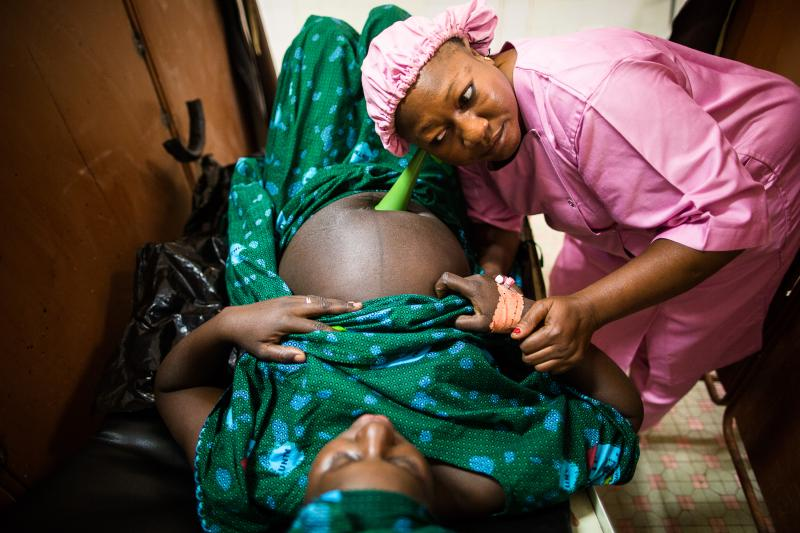 A Malian midwife provides lifesaving maternal care. Throughout Mali, women have a one-in-26 lifetime risk of dying from maternal causes. Access to a midwife or other skilled birth attendant during birth and immediately after would save the lives of many mothers and their babies. It would also prevent complications such as obstetric fistula, a debilitating childbirth injury that can occur during prolonged or obstructed labor. IntraHealth is partnering with the Ministry of Health and other local partners in Mali to address the health workforce crisis and to provide comprehensive maternal care, including repair surgery and care for women who suffer from obstetric fistula. Photo by Trevor Snapp for IntraHealth International.