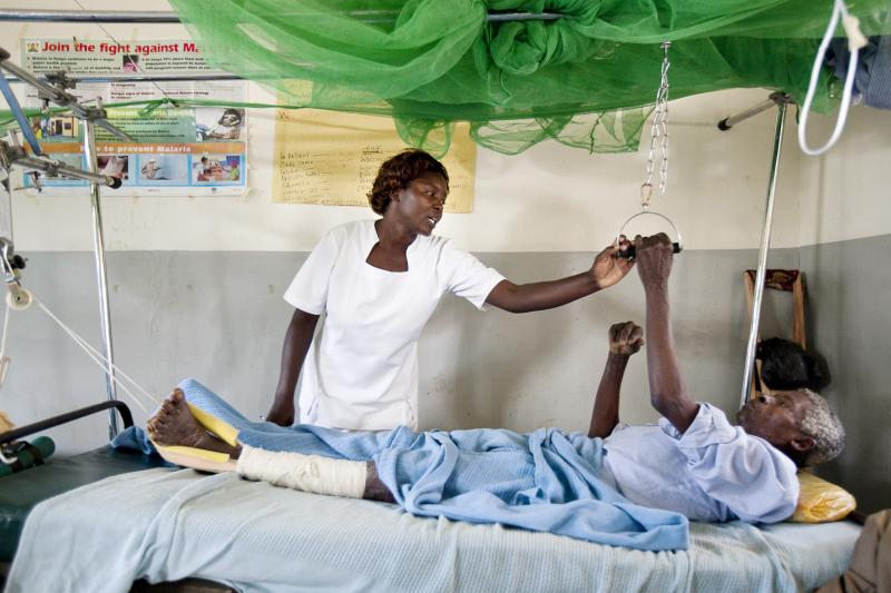 Nurse Ronicah Ong'ayo works with patient at Lugari District Hospital in Kenya. Photo by Trevor Snapp for IntraHealth International.
