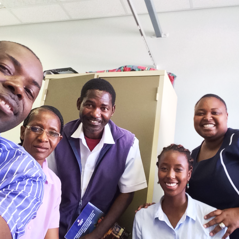 The adolescent care team at Shanamutango Clinic in Namibia, from left to right: Dr. Johnface Fedes Mdala, MD; Ruusa Shipena, registered nurse; Mr. Pedro, registered nurse; Sallay Manah, public health professional and Peace Corps volunteer; and Shirley Gaza, district nurse mentor. Photo courtesy of Sallay Manah.