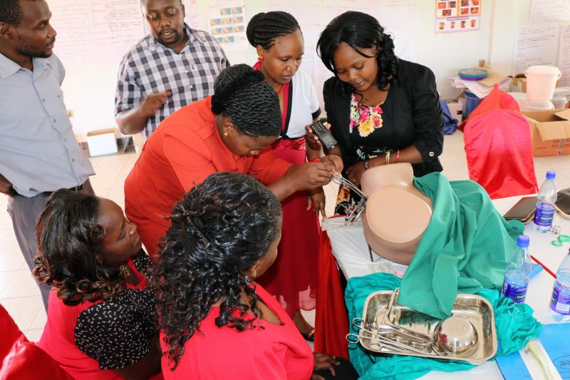 Jane and her colleagues learn how to insert an intrauterine device during the five-day training on long-acting and reversible contraception. Photo by Peter Abwao for IntraHealth International