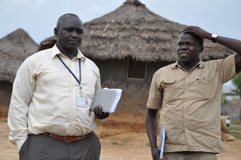 Barnabus Muzale (left), savings and internal lending communities officer for 4Children, a USAID-funded project led by Catholic Relief Services in Juba. This project works in close collaboration with LINKAGES to ensure that children and families affected by HIV are identified and receive the health and other essential services that they need. Photo by Alex Collins for IntraHealth International
