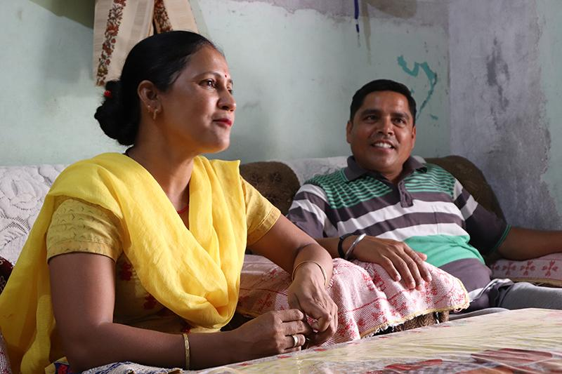 Lalita at home with her husband. Photo by Rahul Kumar for IntraHealth International.