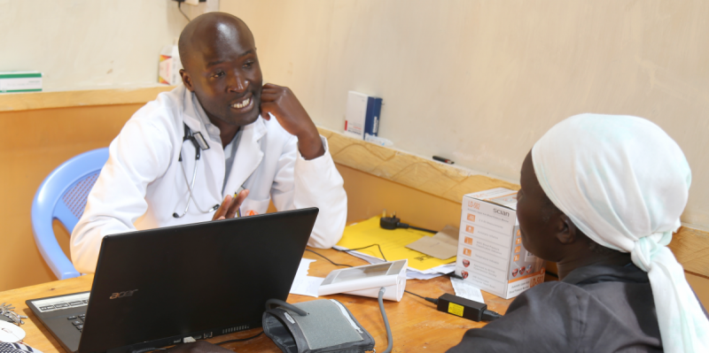 Osoro works with a client in his clinic in rural Kenya. Photo by Tervil Okoko for IntraHealth International.