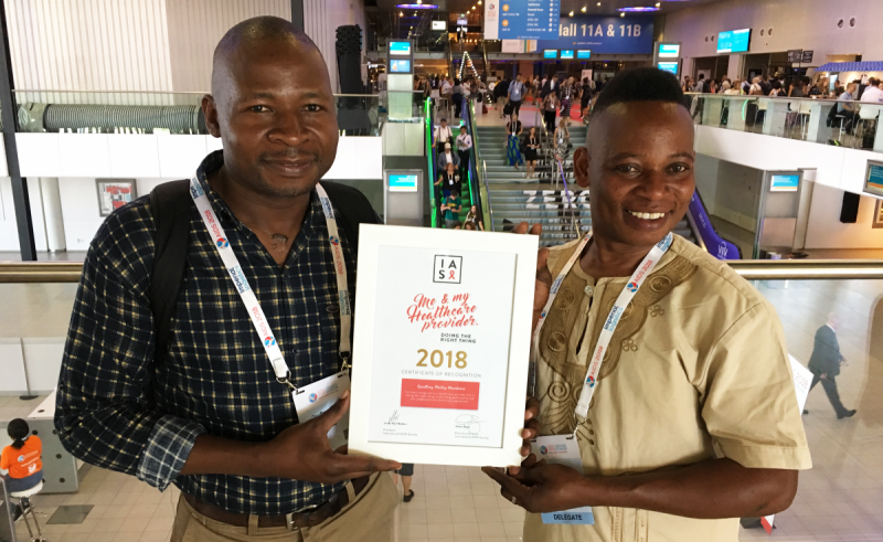 Phillip Wandawa (left) and Mrs. Pontoshi accepted their award last week at AIDS 2018 as part of the ceremony for Me & My Healthcare Provider: Doing the Right Thing. Photo courtesy of Lindsey Freeze.