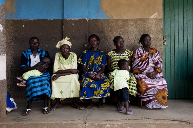 Clients wait outside the Saint Bakhita Health Centre in Yei. The health repercussions of losing a highly skilled frontline health worker such as Sister Veronika could affect this community for generations. Photo by Trevor Snapp for IntraHealth International.