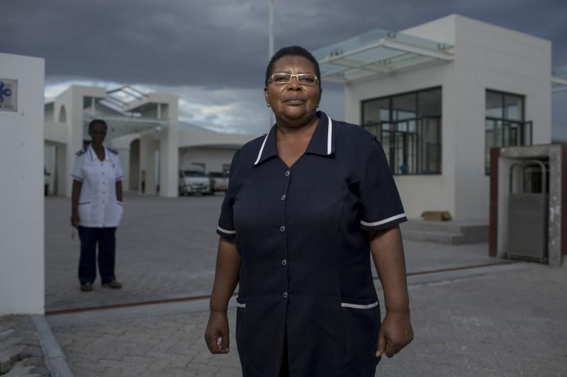 "Naomi Nanus, 64. Omuthiya District Hospital, Namibia. Without exception, each of the unretired nurses interviewed for this story said that for them, nursing is a calling—something they felt they had to do to help people. ""It's not about what you do with your hands,"" Nanus says. ""It's about how you care with your heart."" Photo by Morgana Wingard for IntraHealth International."
