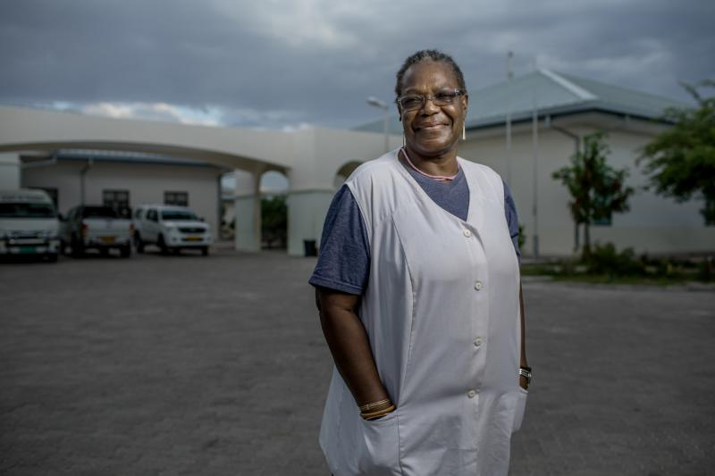 "Olivia Nandy, 68. Omuthiya District Hospital, Namibia. When Nandy's daughter died at age 36 of AIDS-related causes, she says, ""it hurt me very much. I decided then that the people who come after my daughter must not die. I must take care of them. Wherever I am going, I must take care of those people."" Photo by Morgana Wingard for IntraHealth International."