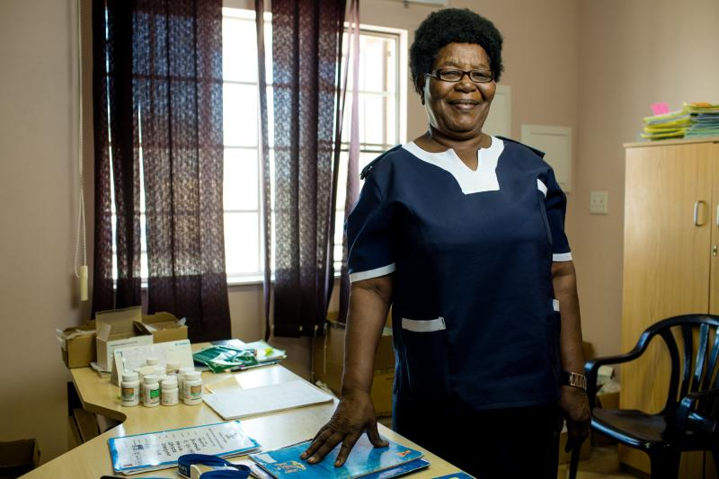 "Paulina Haugo, 67. Omuntele Clinic, Namibia. Nicknamed Kuku, or grandmother, Haugo is highly revered in her community. Not only is she considered elderly at 67, but she's also a head woman in her village, an elder in her church, and a highly skilled nurse. ""Even the men listen when she talks,"" her colleagues say. Photo by Morgana Wingard for IntraHealth International."