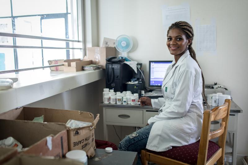 """Being alone, you learn more and faster,"" Elina says. ""But we need another person in our pharmacy, so that when one is dispensing the medications, the other is entering data into the computer."" Photo by Morgana Wingard for IntraHealth International."