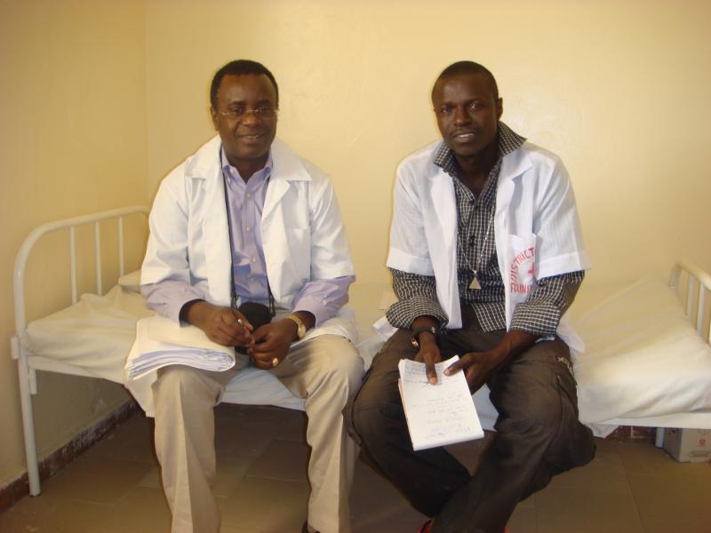 Dr. Boniface Sebikali, IntraHealth's senior clinical advisor with Mr. Ibrahim Sarr, in–charge for Damaniadio Health Post in Foundiougne District. His facility is using Tutorat to improve its services. Photo by IntraHealth International.