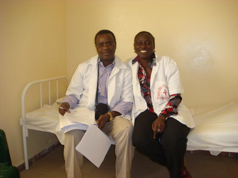 Dr. Boniface Sebikali, IntraHealth's senior clinical advisor, with Mrs. Djirnda Mane Nogaye Sarr, a midwife and tutor trained in Tutorat, in Damaniadio Health Post, Foundiougne District. Photo by IntraHealth International.