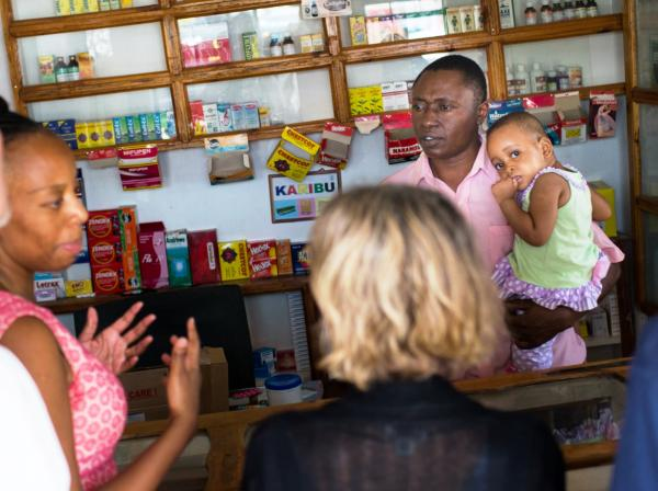IntraHealth staff speaking with pharmacist in Tanzania