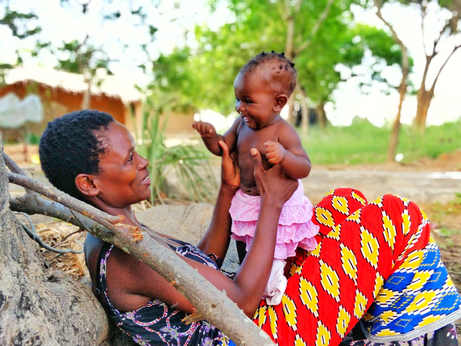 A happy young mother with her infant in Zomba, Malawi. Photo © 2018 Nandi Bwanali/One Community, Courtesy of Photoshare.