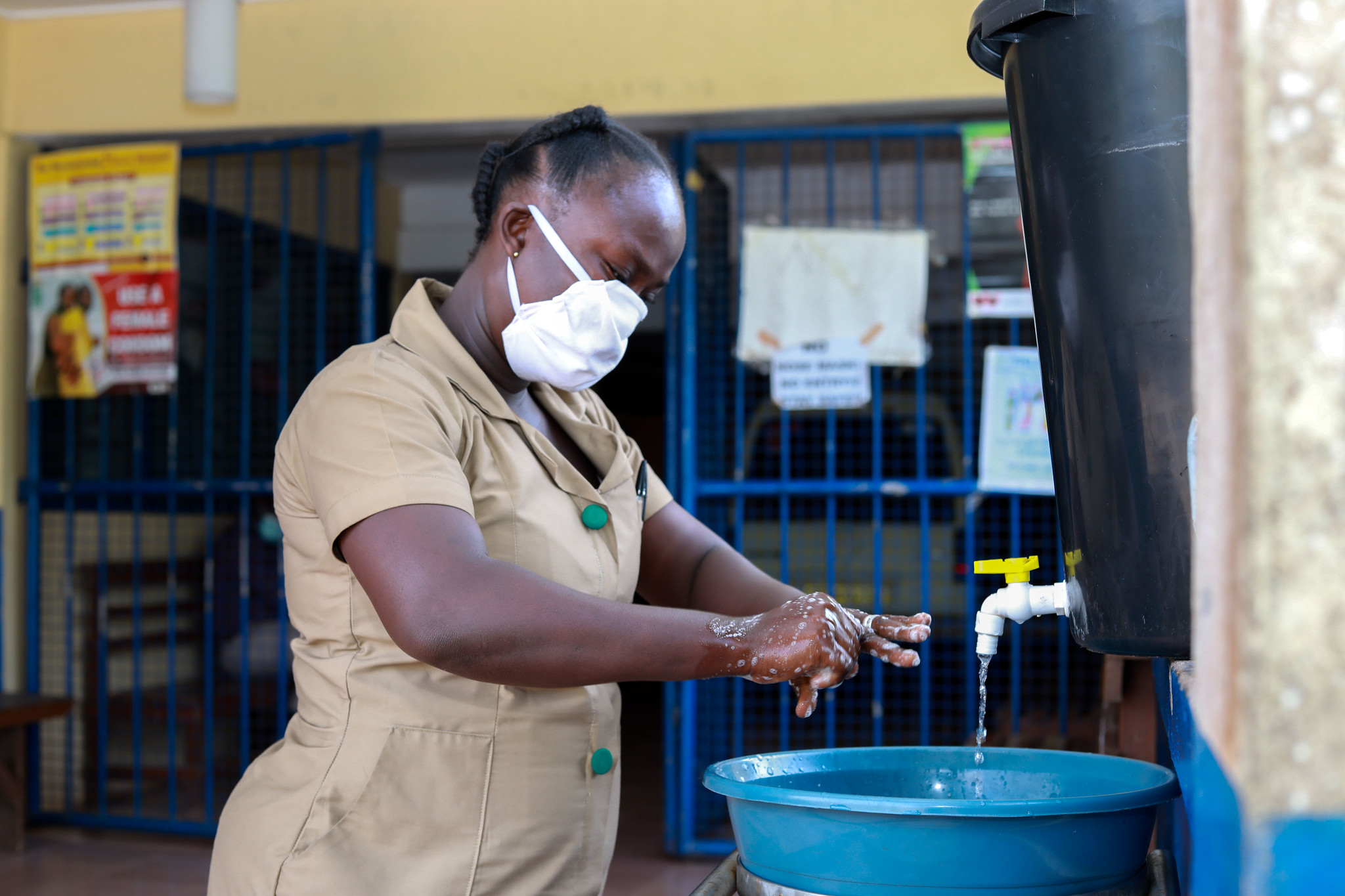 Community Health Nurse Olivia Yeboah thoroughly washes her hands at the Akropong Clinic in Ghana. Photo by Emmanuel Attramah, PMI Impact Malaria / U.S. President's Malaria Initiative.