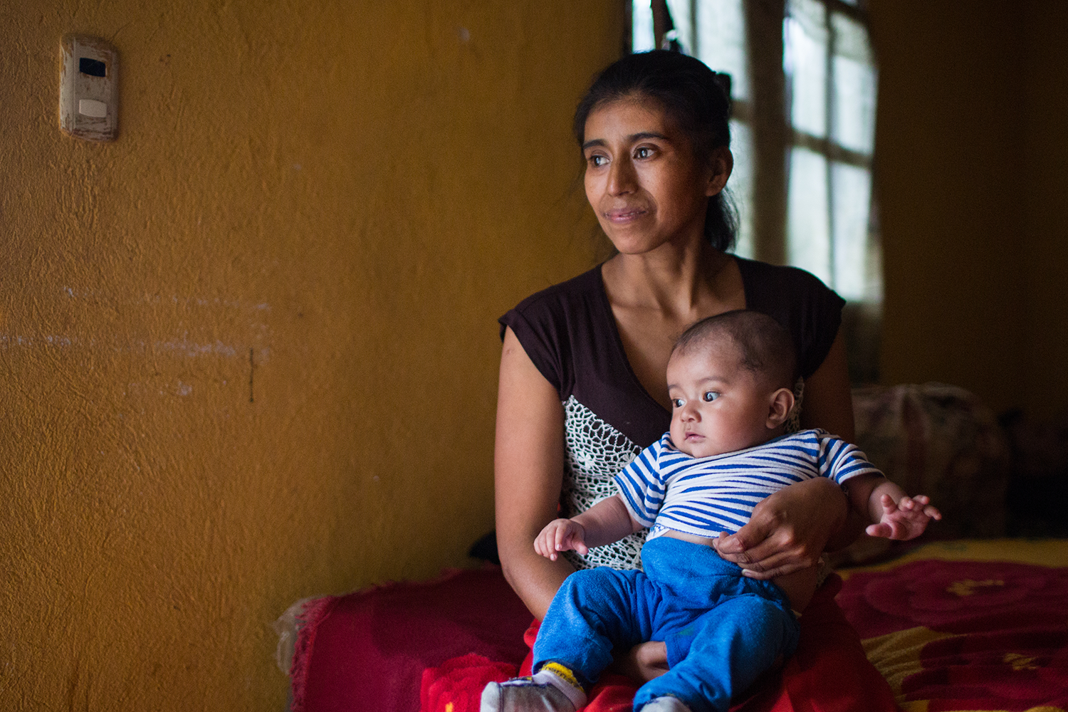 There are and always will be global health challenges to face. But there's boundless hope, too. A mother and child wait for health services at Hospital Nacional Juan José Ortega in Guatemala. Photo by Anna Watts for IntraHealth International.