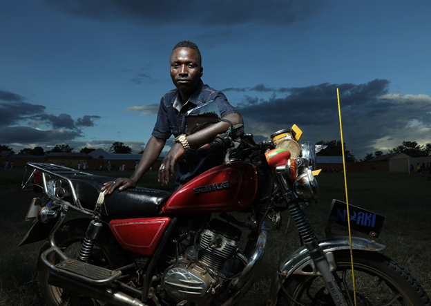 January Jacob, 25, tells his fellow boda boda drivers to take care of themselves and to use condoms. Photo by Josh Estey for IntraHealth International.