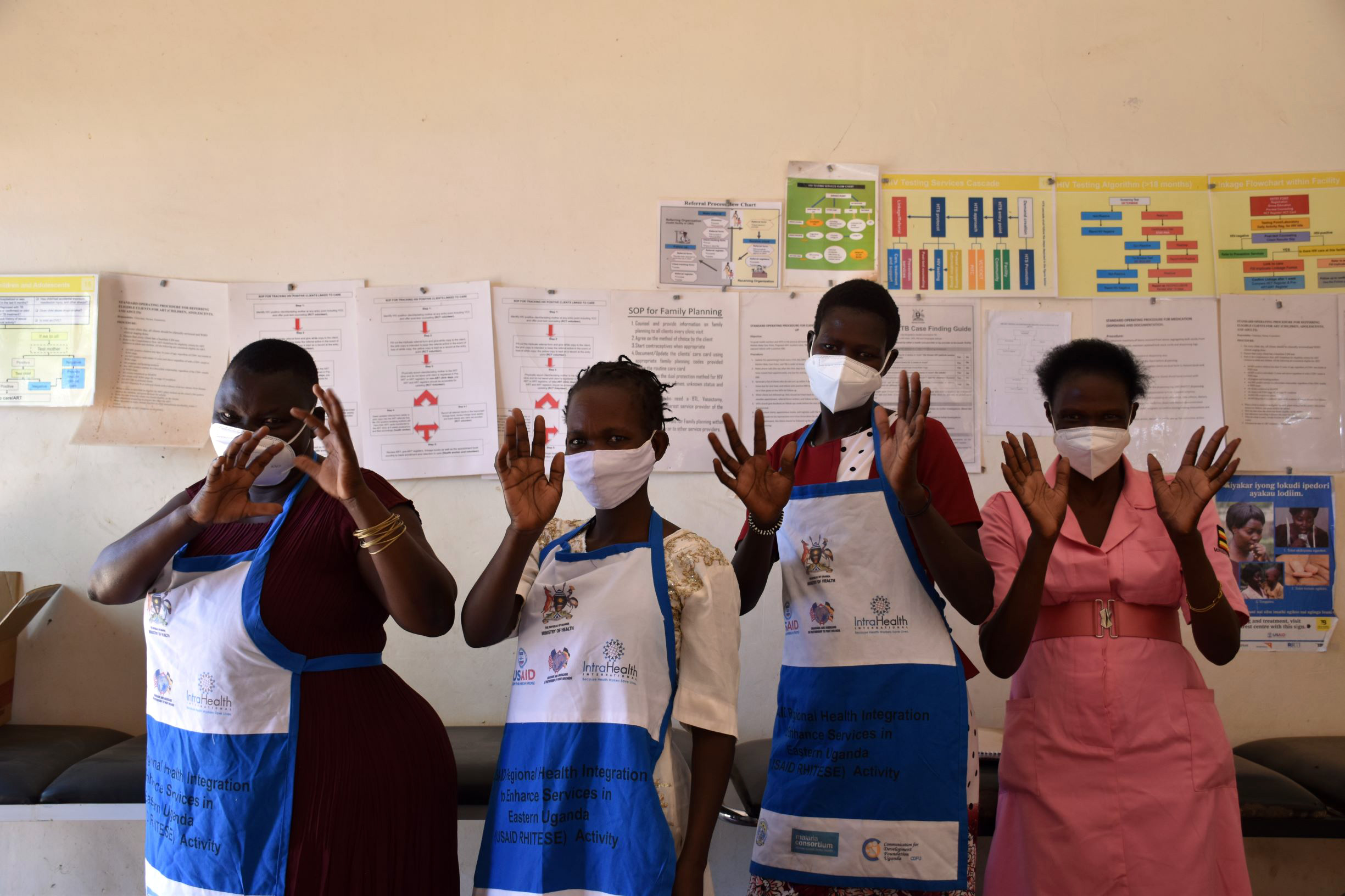 Lucy, Grace, Florence, and Hellen are working together to improve HIV services in Eastern Uganda. Photo by Irene Mirembe for IntraHealth International.