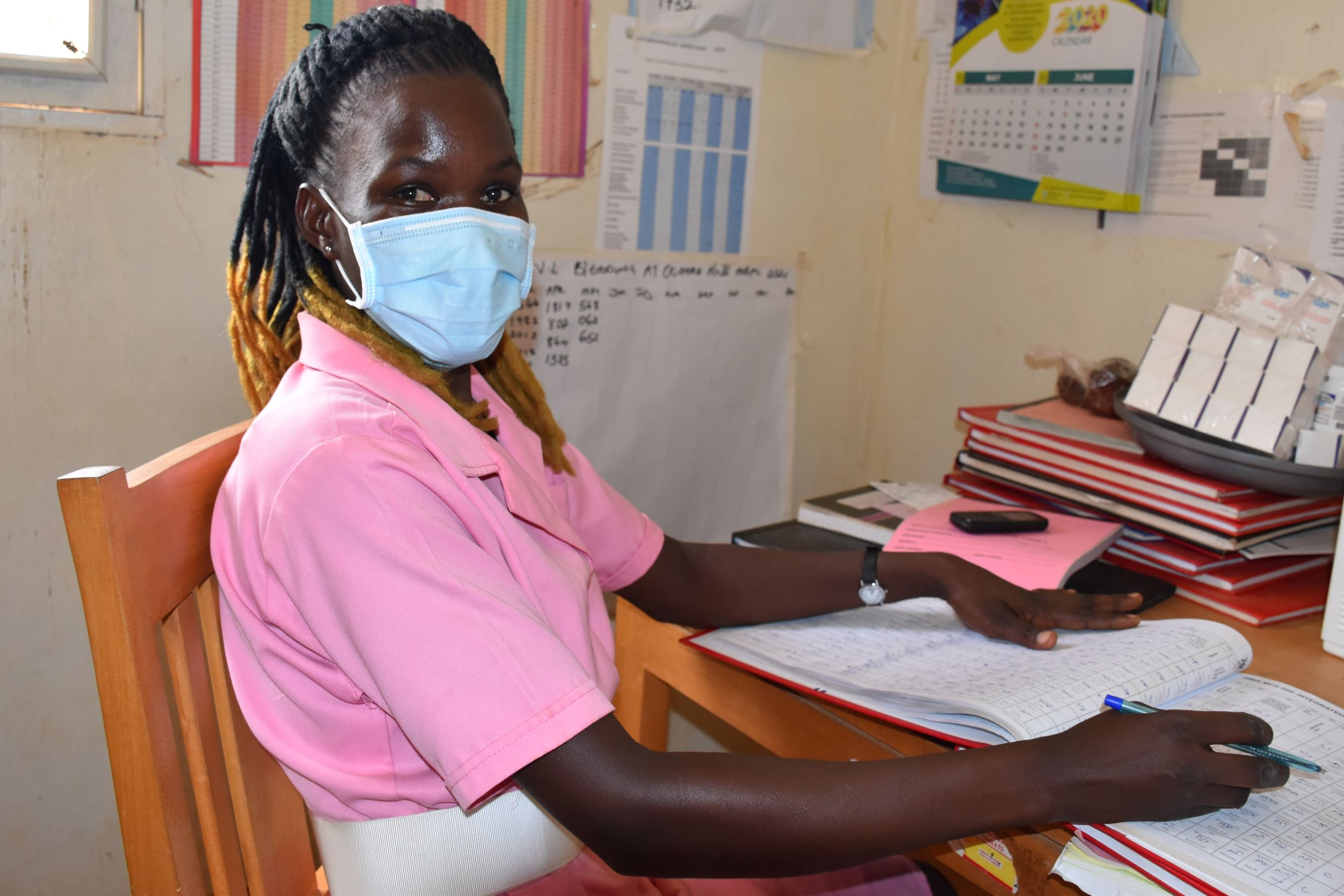 Catherine, a midwife at Ochero Health Center III, adapted quickly to continue providing high-quality maternal and child health services to mothers who come to the health center. Photo by Irene Mirembe for IntraHealth International.