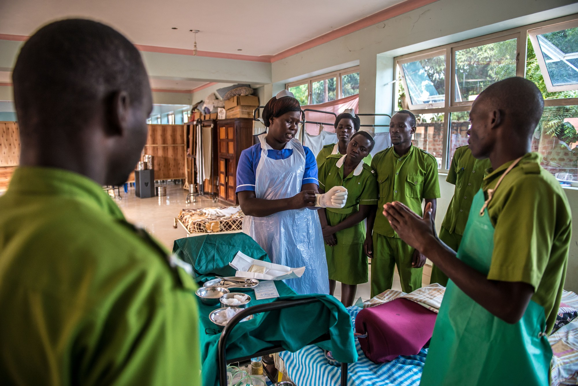 Beatrice Aciro, midwife and graduate of Good Samaritan School of Nursing & Midwifery, conducts a practical exercise with students. Photo by Tommy Trenchard for IntraHealth International