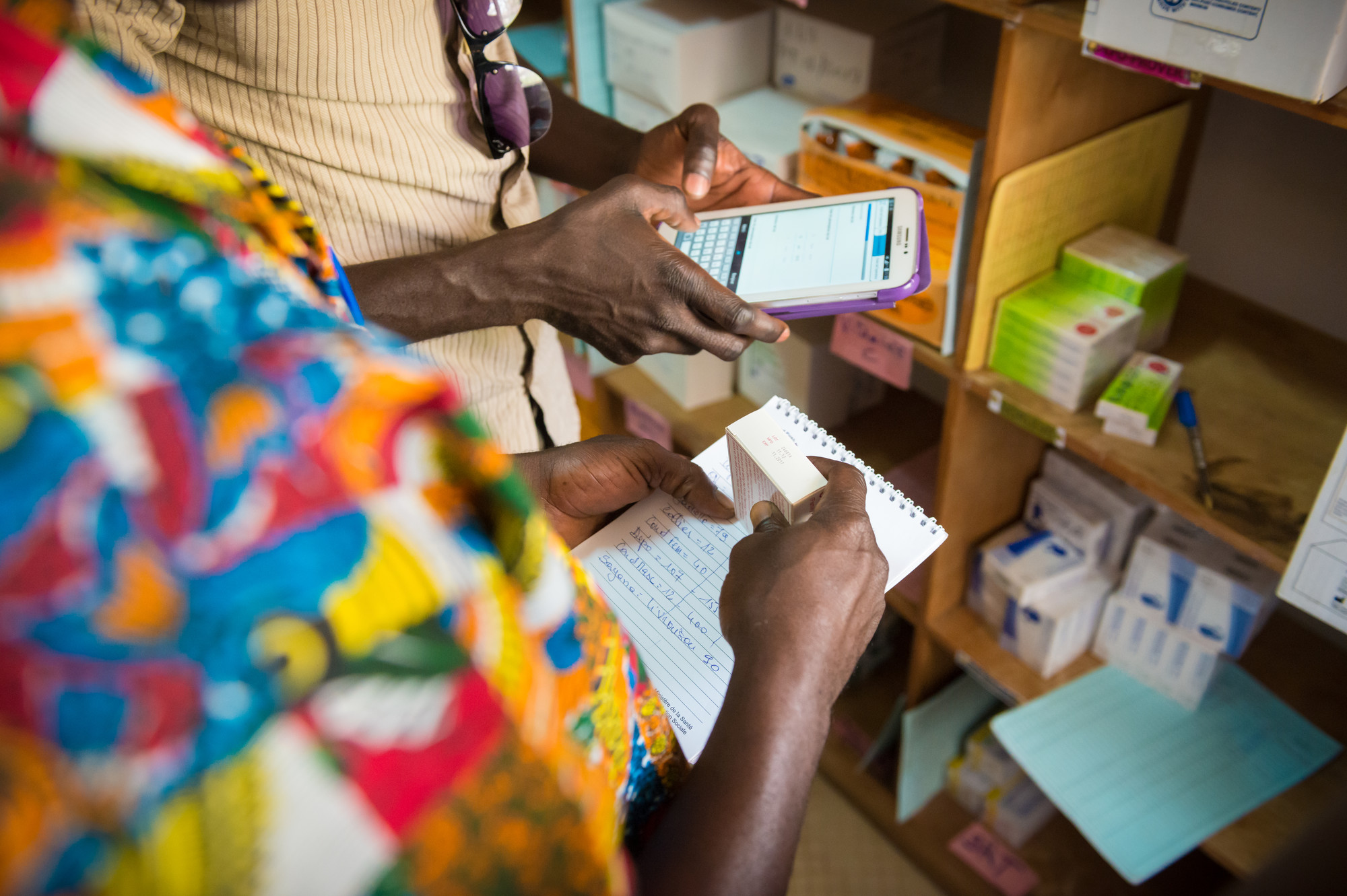 Smartphones have revolutionized the way health workers do business. Photo by Clement Tardif for IntraHealth International.
