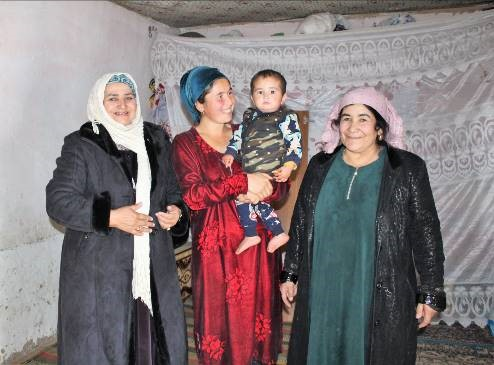 Malika Pirimova poses with health volunteers and her son in Vakhsh District. Photo credit: Tajikistan Health and Nutrition Activity.