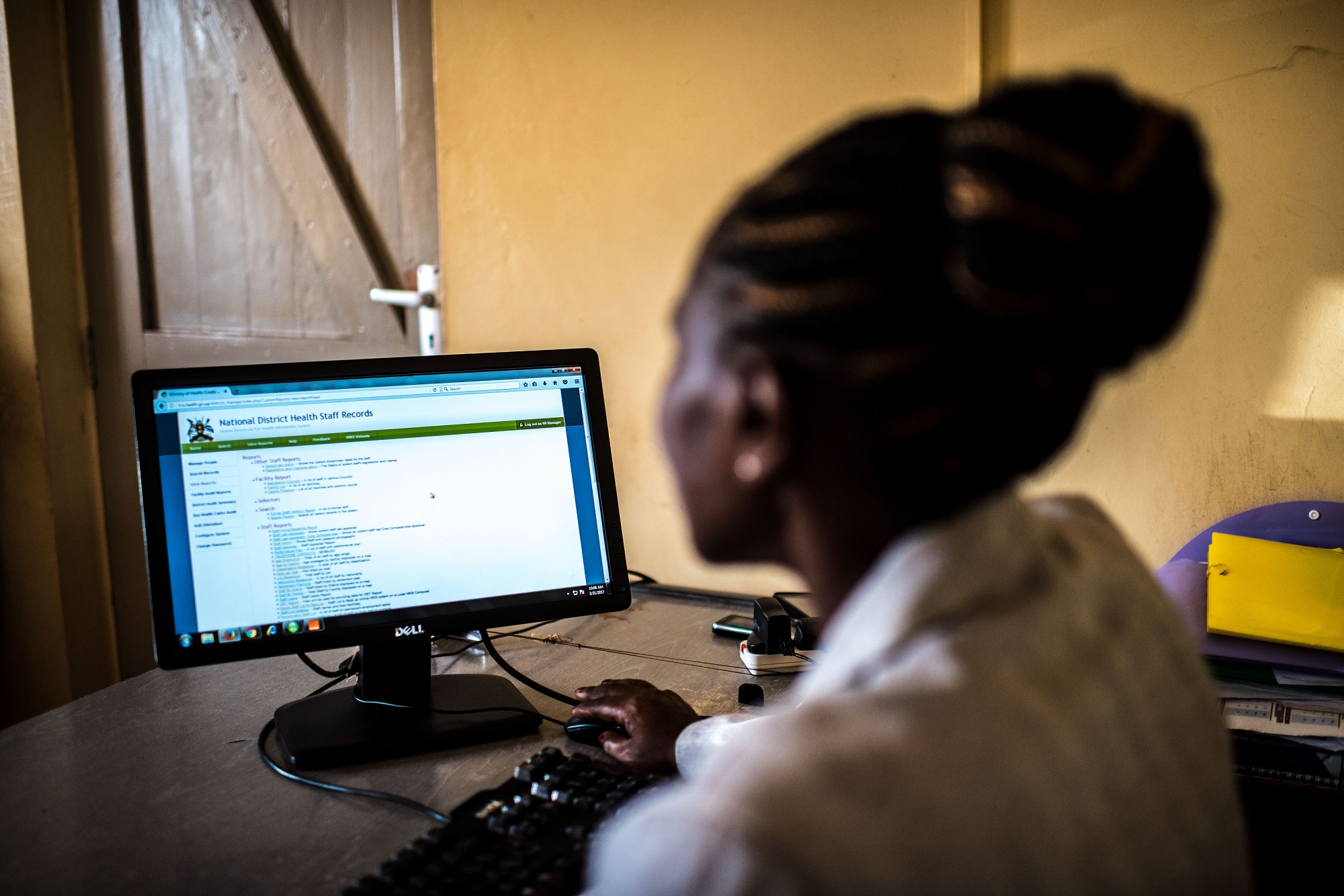 Health officials in Uganda use iHRIS to track health workforce data. Photo by Tommy Trenchard for IntraHealth International.